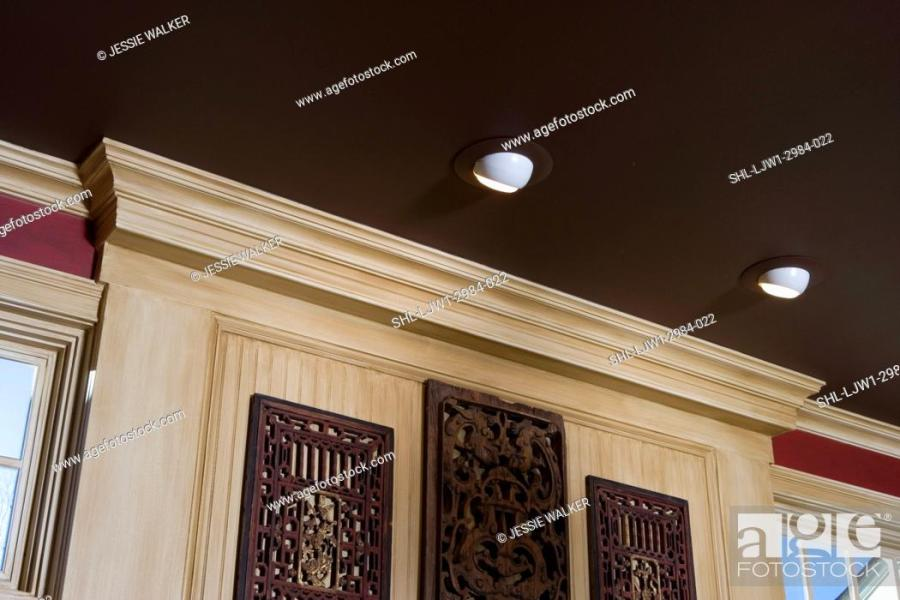 ARCHITECTURAL TRIM  Dark brown painted ceiling   light stained wood     Stock Photo   ARCHITECTURAL TRIM  Dark brown painted ceiling   light  stained wood trim  red walls