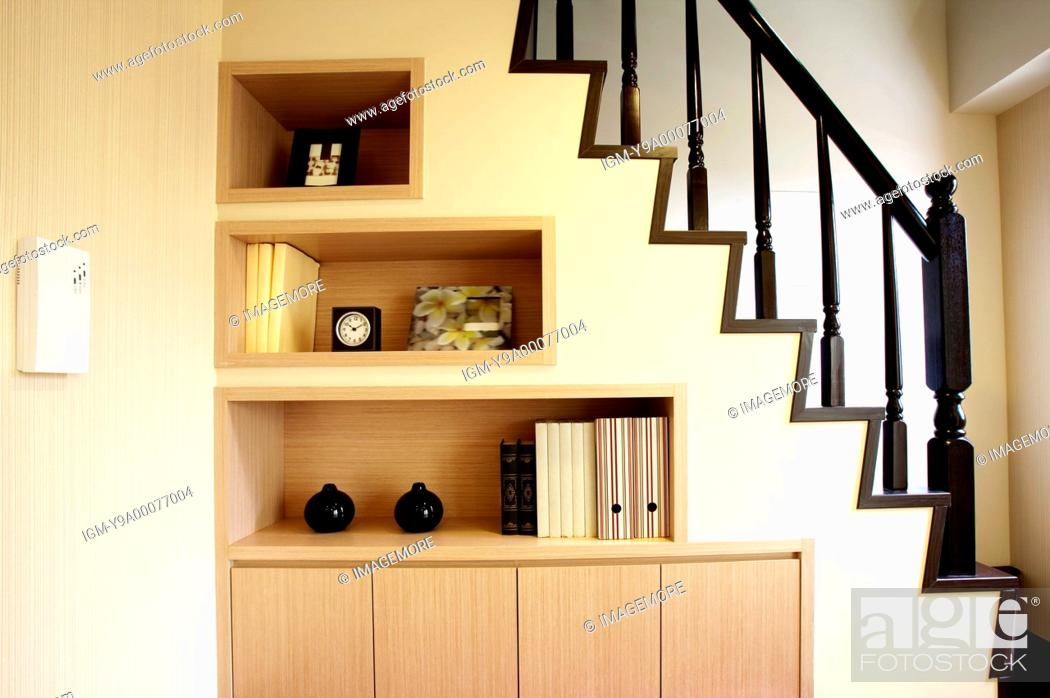 Built In Wardrobe Under Staircases Stock Photo Picture And | Wardrobe Design Under Stairs | Shoe Rack | California Closets | Shoe | Space | Stairs Storage Solutions