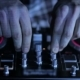 Hands Of DJ Which Mixes Music Tracks CD Mixer In Nightclub 14