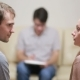 Male Psychologist Helping Worried Young Couple. Family Therapy. Angry People