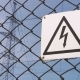 Power Substation. Warning Sign About the Risk of Electric Shock. High-voltage Wires on the Support