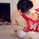 Pretty Little Girl Plays with Her Mothers Hair