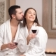 Happy Beautiful Couple Drinking Champagne and Relaxing in a Spa Centre.
