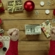 Man Unboxes Christmas Gift Box with Cash Money Inside, Top Down Shot