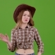 Cowboy Style Girl Closes Her Nose, Smells Unpleasant Around Her. Green Screen