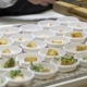 The Chefs Prepare Food Samples for Visitors During the Food Show