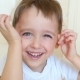 of a Baby Boy Looking and Smiling at the Camera at a Slowed Pace. The Child Shows Joy and a Big