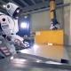 Robot Welds a Metal Sheet