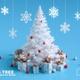 Christmas tree with Christmas lights and gift boxes