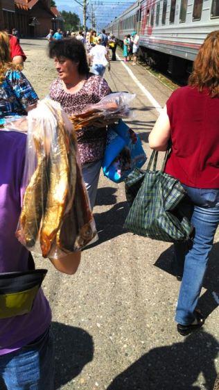 buying Omul, smoked Baikal fish