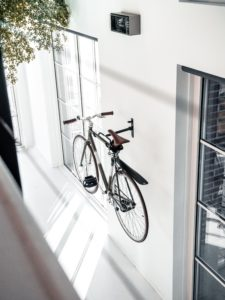Bicycle on the wall - one of small apartment design ideas.