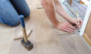 worker measuring floor