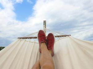 person relaxing in a swing