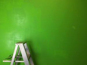 Green wall with white ladders