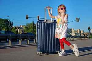 the kid with the luggage in summer