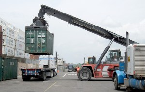 Machine is loading a container on the truck