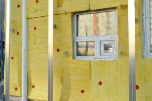 Home insulation process as one of the home improvements to complete before moving in