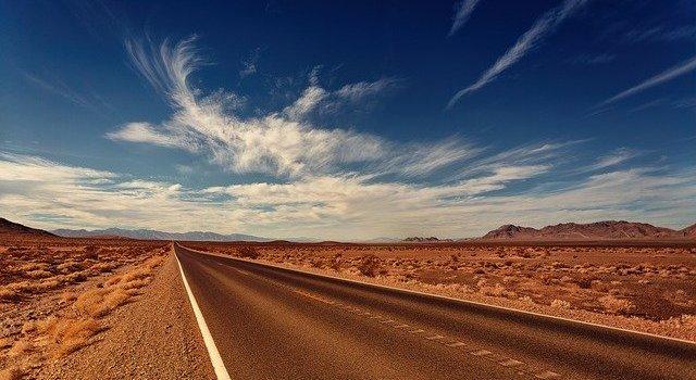 A road in Nevada in a desert.