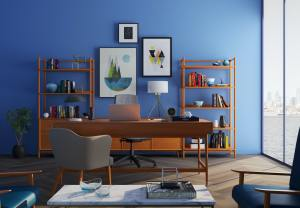 A bright blue accent wall with lots of Nordic-style, light wood furniture