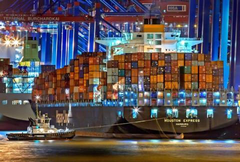 Cargo ship that is shipping pieces of furniture