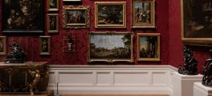 Gallery wall covered with paintings