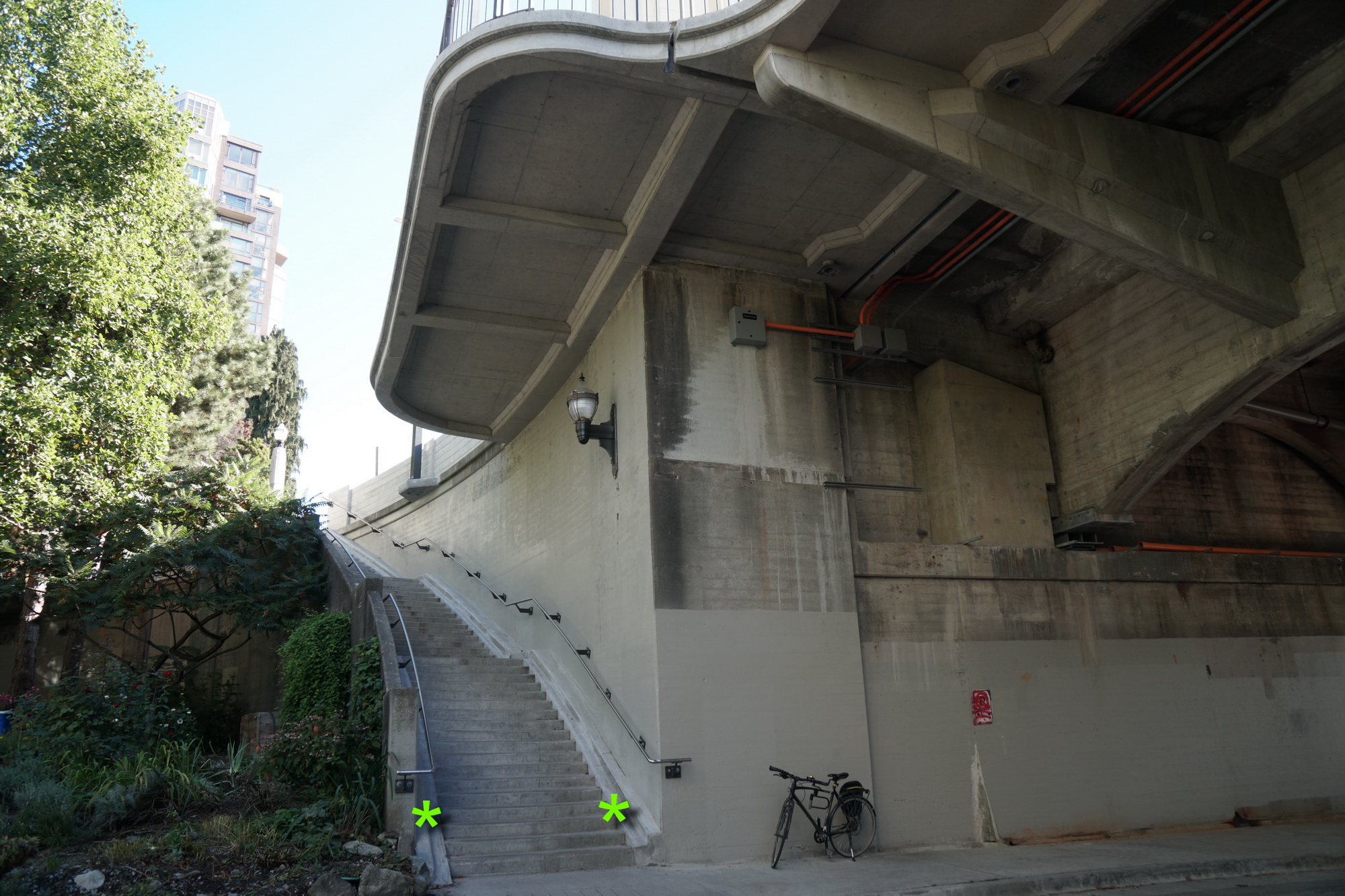 West-side stairs, with bike-friendly runnells (*). And evidence of structural upgrades.