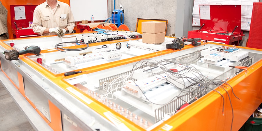 Distribution board being manufactured