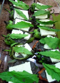 Chiles de agua, stuff with black beans, cheese, and an epazote leaf
