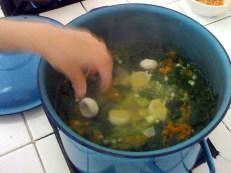 Adding dumplings to the soup