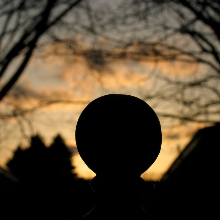iron ball Fence post top at dusk