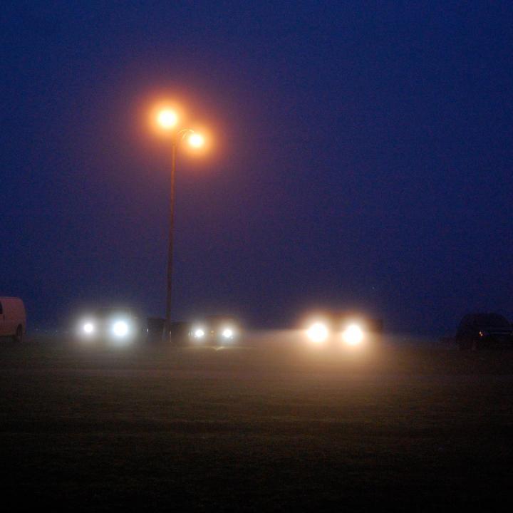 Headlights in the dark mist