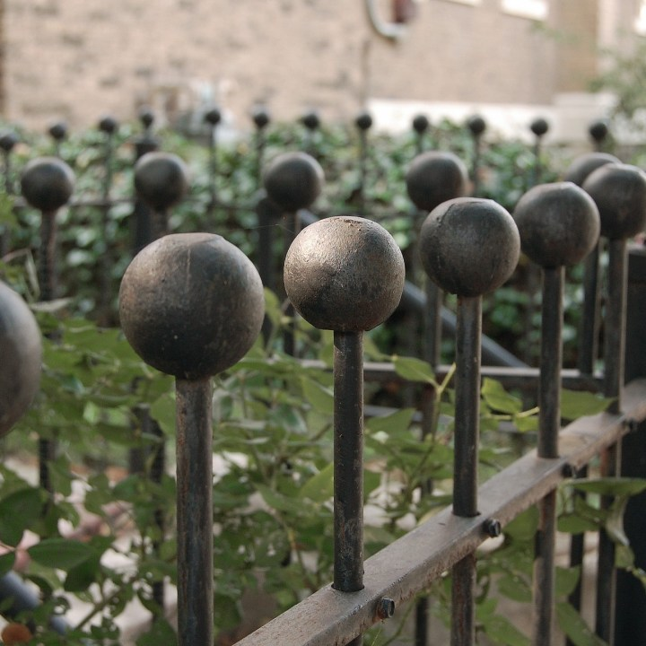 Black Iron fence top balls in receding zig-zag pattern
