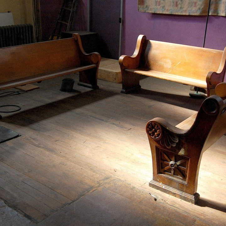 Church pews in gallery splashed in sunlight