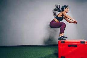 image of a women in athleticwear jumping onto a red box
