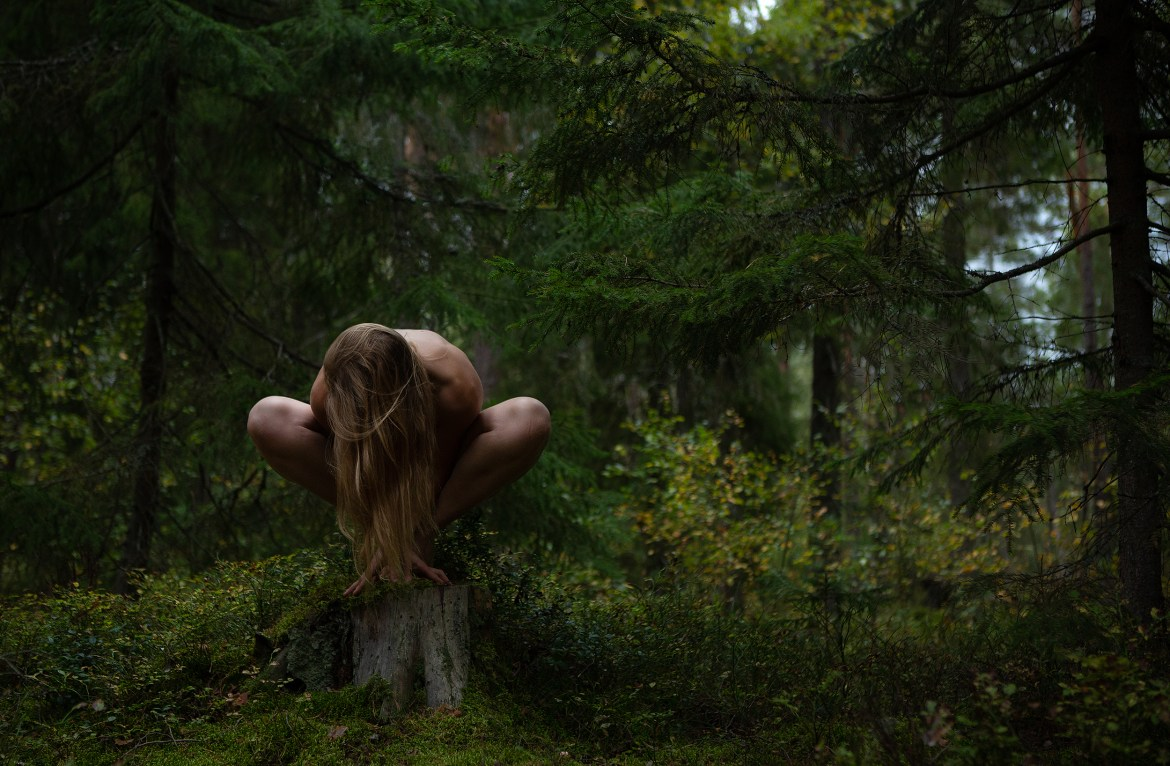Naked woman in the woods, Stockholm, Sweden