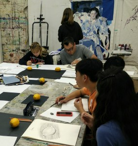 Artists draw and paint during the Studio Coaching sessions.
