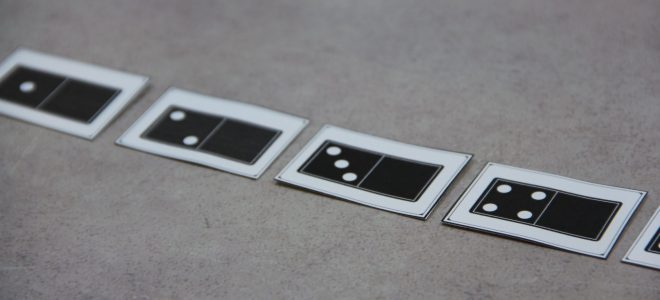 Five cards in a line. Each card shows a domino with 1-5 dots to encourage students to use subitizing to identify the quantity.