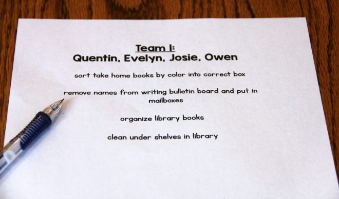 Photo of Clean-Up Team List: 4 student names across the top with 4 specific clean-up tasks for this clean up team.