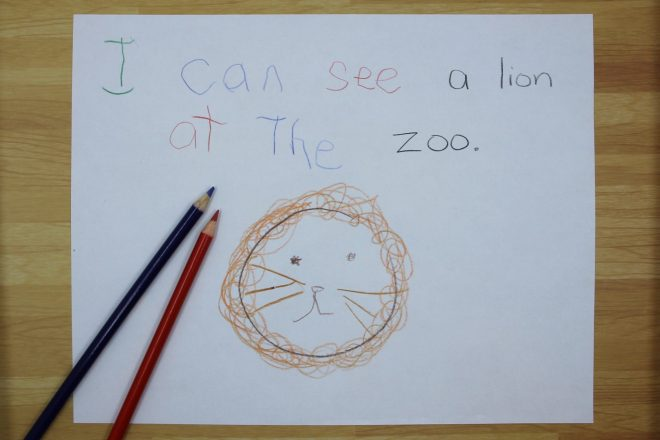 "Example of an interactive writing text that says ""I can see a lion at the zoo."" students wrote the following high frequency words: I, can, see, at, the."
