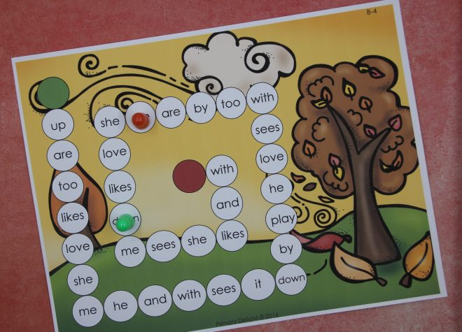 Photo of a trail game with high frequency words printed in the spaces. The game includes a fall scene in the background.