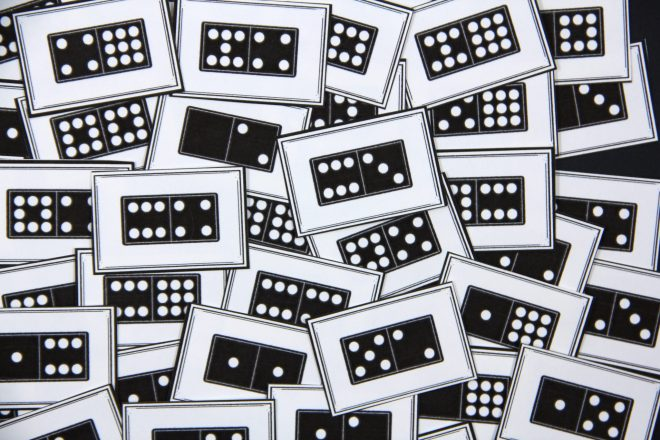 Photo of a number of game cards each displaying a domino.