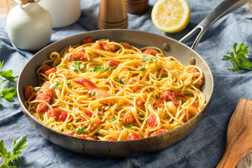 Savory Homemade Lobster Pasta with Parsley and Tomato