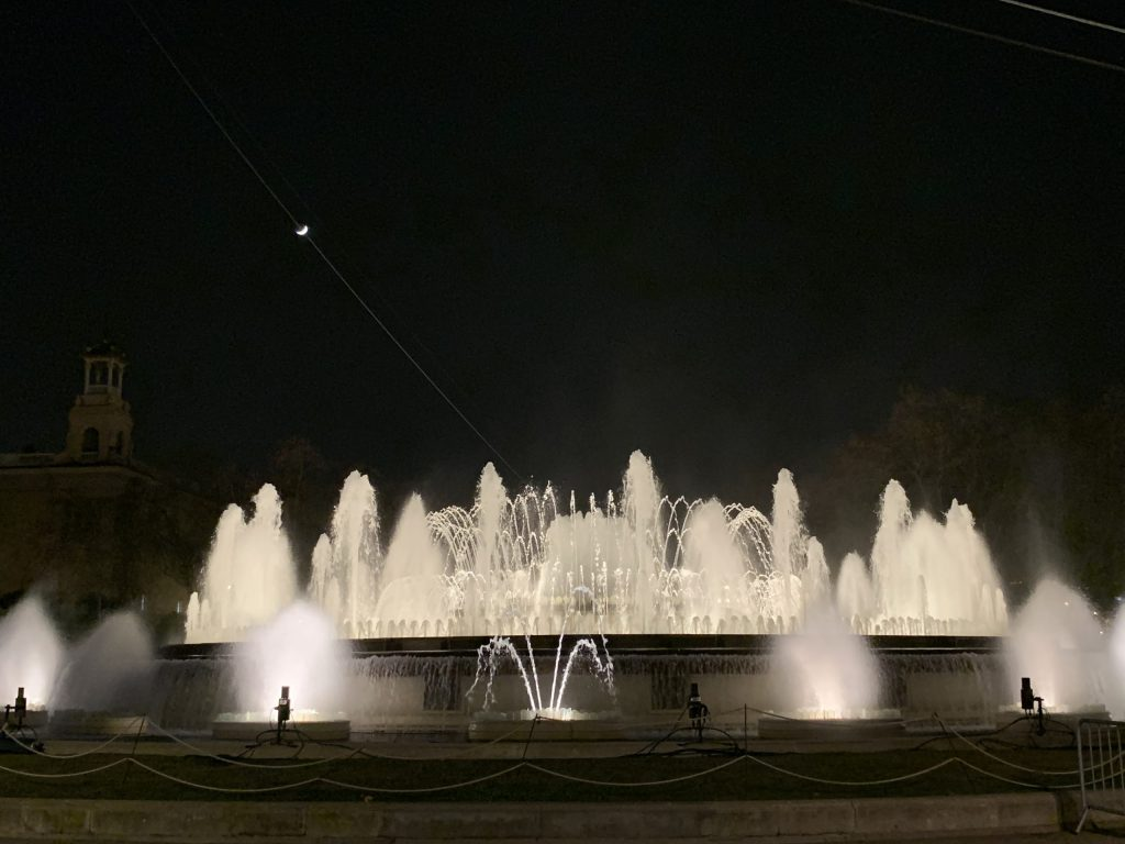 Multiple water jets spray in the air from fountain