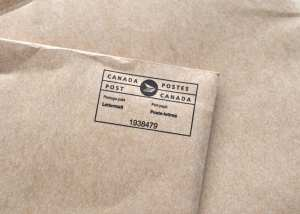 """Vancouver, Canada -- April 7, 2012:Close up of Canada Post Postmark indicating postage paid on an envelope.  Canada Post is the national mail service of Canada."""