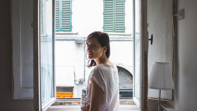 Woman with White Short at the Window
