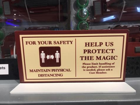 señalización seguridad Covid Disney tienda