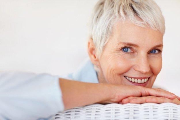 Happy senior woman posing