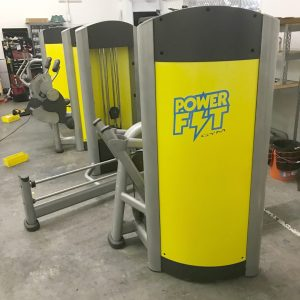 Custom yellow shrouds and logo on strength equipment