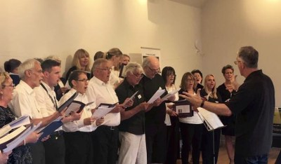 The Insole Court Community Choir in performance with Tim Riley