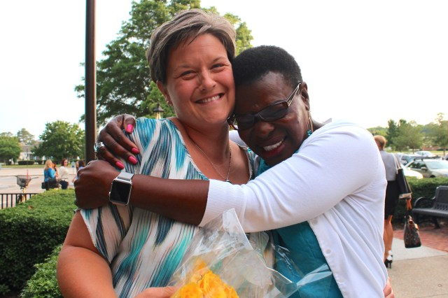 Casey Conger, left, gets a big hug from Point O'View Elementary Principal Paulette France on Tuesday, June 9, 2015, following a meeting of the School Board. Conger, the assistant principal at Point O'View, was announced as the next principal of Creeds Elementary School during the meeting. [John-Henry Doucette/The Princess Anne Independent News]